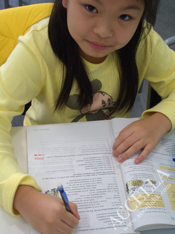 VivienT1996 completing her in-class grammar exercises.  The red-stamped sections are part of this week's homework.