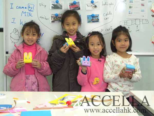 Four students from our XMas 2006 English Crafts program proudly displaying their creations.