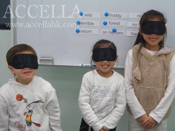 From left: Kevin, Edy, and Debbie have donned their blindfolds before playing a round of 'Build a Sentence'.