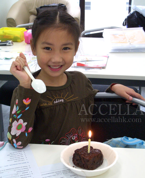 Chloe about to blow out the candle on her birthday brownie.