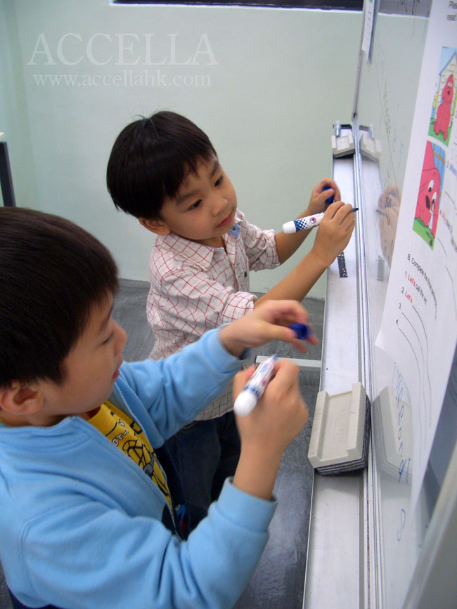 Henry and Alvin competing to finish their reading comprehension answers.