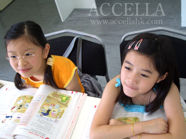 Lillian (left) and Charis (right) enjoying the grammar portion of their lesson.