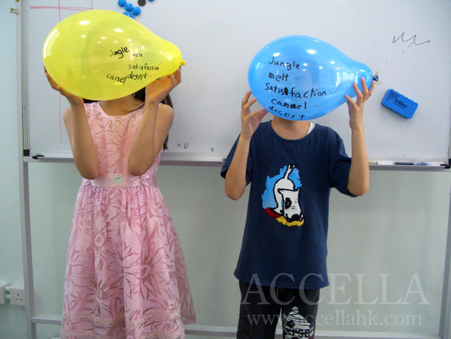 Daisy and Matthew (left and right, respectively) holding up their vocabulary balloons