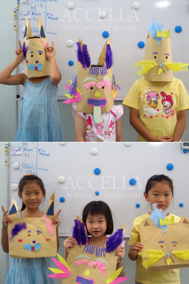 Three students from our Summer Fun class showing off the masks that they had made for an activity in support of a procedural writing exercise.