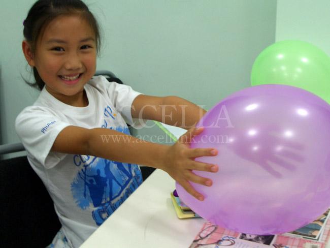 ChloeP holding a balloon during balloon time