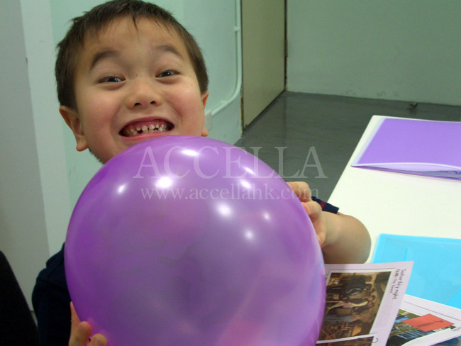 KevinM holding a balloon during balloon time