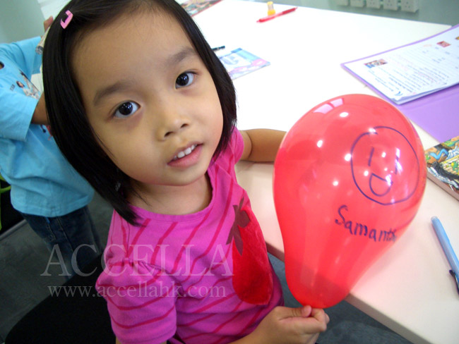 SamanthaC holding a balloon during balloon time