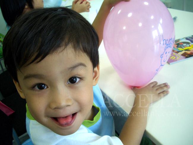 ThomasC holding a balloon during balloon time