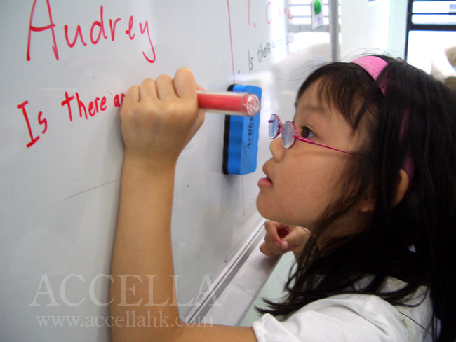 AudreyC crafting a question using the 'is there'/'are there' construction for countable/uncountable nouns.