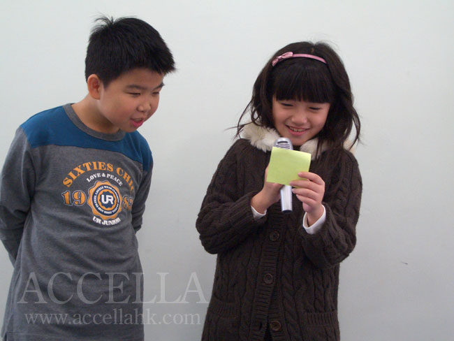 LucasC (left) and CharisL asking each other five questions using 'ing' forms of verbs.