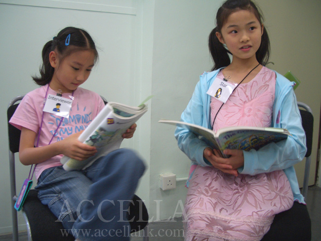 Left to Right: ChloeP listening to KevinM (off-screen at right) report DiasyL's answers to her questions.