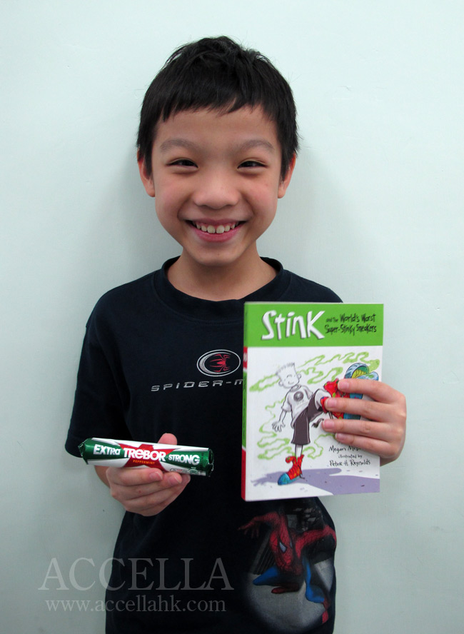 BrandonC holding his pack of peppermints and his copy of 'Stink and the World's Worst Super-Stinky Sneakers'.
