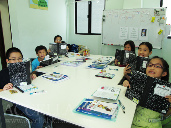 Our students holding their marble composition notebooks.