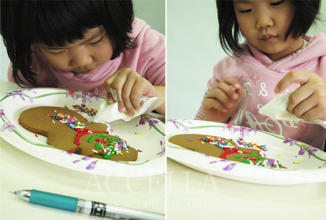 AlvinaT skillfully applying icing to her gingerbread man..