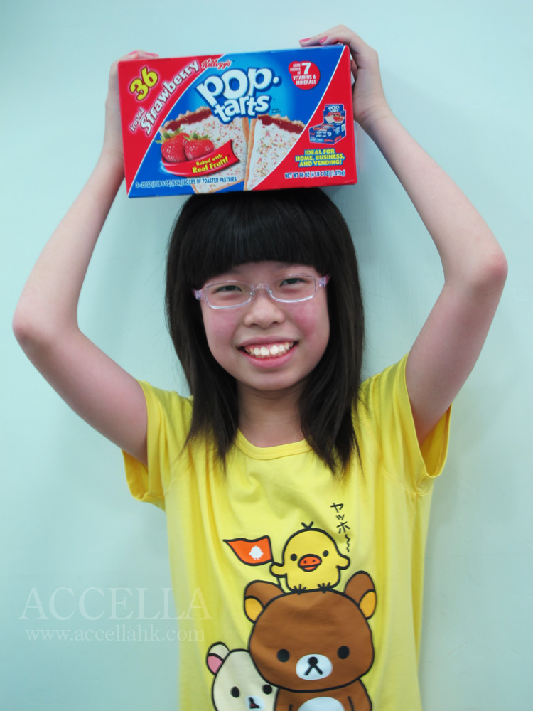 LeahC balancing a commercial-sized box of strawberry-flavored Pop-Tarts on her head.