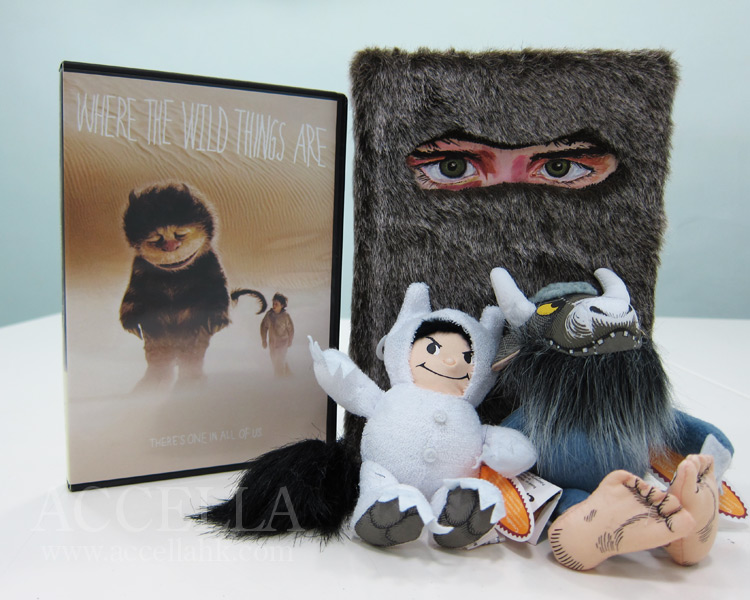 DVD of Spike Jonze's 'Where the Wild Things Are', a copy of Dave Eggers's 'The Wild Things', and two plushies from the film's merchandizing push: Max and the Bull.